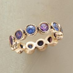 "LOVE SHINES ON RING�--�A 14kt gold sapphires ring that aligns sapphires in cool hues, Jes MaHarry�engraves the bezels with ""love"" on one side, ""shine on"" on the other. 14kt gold"