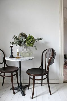 I love this petite dining space for two. The marble table perfectly complements the black chairs and crystal globe.