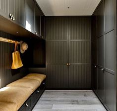 In this modern mudroom, large overstuffed light brown leather pillows cushion the built-in bench with storage, while black cabinets with leather drawer . Interior Exterior, Home Interior, Brown Interior, Built In Bench, Built Ins, Black House, Modern Farmhouse, New Homes, House Design