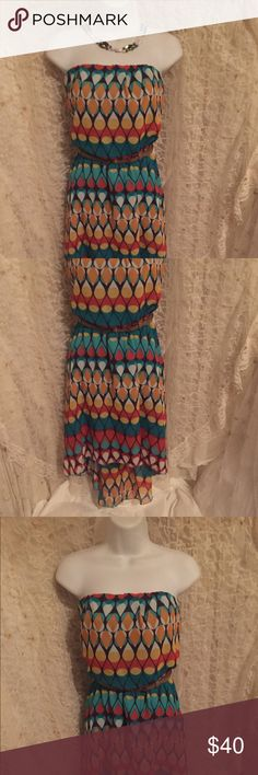 Love Reign dress Brand new. Never worn or washed. Gorgeous strapless high low dress. Soft & silky & beautiful colors. Fully lined in Turquoise. 100% polyester. Flawless. The original belt is missing so I'm including a nice leather belt. Love Reign Dresses Strapless