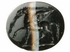 A Roman jeweller hid four intaglios (engraved stones for finger-rings) in a pot buried in his workshop when Boudica attacked London in AD60.This stone shows the mythical horse Pegasus, a symbol of immortality. The engraver, at this time of London's development, must have been an immigrant craft worker and was highly skilled. -  Museum of London