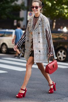 Cape blazer, and red platform sandals! Love street style? Check out all the best looks from Milan Fashion Week.