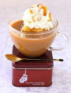 DIY Salted Caramel Hot Chocolate ~ Yields: 10 servings    1/2 cup sugar  1/2 cup water  1-1/2 cups heavy cream  1/2 teaspoon pure vanilla extract  1/2 teaspoon cornstarch  1 teaspoon cocoa powder, + extra for dusting  6 cups whole milk  1/8 teaspoon sea salt (or regular salt)  1/2 cup whipped cream (optional)