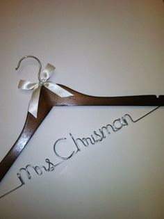 Cute hanger, maybe with tiffany blue ribbon or coral? :)