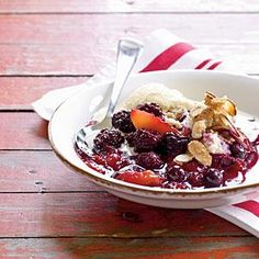 Take peach cobbler to a whole new level by adding blueberries and blackberries which yields a sweet, juicy dessert that's the epitome of summer.
