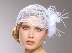 Wedding Headpiece Vintage Inspired Bridal Cap andmade designer bridal cap is inspired by Shakespearean Juliet cap and by Grace Kelly's wedding cap. Our lace cap has a 5 inch wide x 8 inch tall hair clip with an organza flower and ostrich feathers. The romance of the Renaissance period and the royal wedding of Grace Kelly have inspired this haute couture yet vintage wedding statement headpiece by Mariell