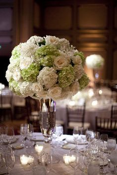 Springy white and green floral wedding centerpiece (Photo by lunaphoto)