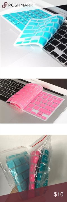 3 PACKS SILICONE KEYBOARD COVERS MACBOOK PRO Used once comes in the colors (1) turquoise, (1) pink, and (2) baby blue. Selling 4 total together.  This can be used for Macbook Pro Laptop for keyboard covers! ****Comes with a free gift of anti-dust plugs for laptop Accessories Laptop Cases