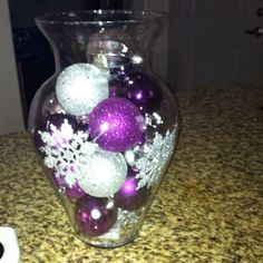 Made this too...ornaments and snowflakes in hurricane vase