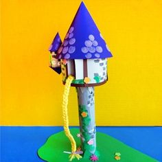 """Looking for a fun way to spend a rainy day when you're trapped in your house like Rapunzel? This easy-to-make """"Tangled"""" Tower Craft is perfect for crafting with your kiddos and creating memories they'll never forget. Disney Diy, Disney Princess Crafts, Disney Crafts, Kids Crafts, Cute Crafts, Crafts To Do, Craft Projects, Paper Crafts, Rapunzel Birthday Party"""