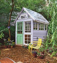 Potting Shed with Salvaged Parts-A whimsical backyard structure, this custom greenhouse is comprised of found windows of varying sizes. The solar-panel roof heats the interior, and a stained-glass window offers a bit of decorative style. Periwinkle blue walls and a neon green door add garden-fresh color to this one-of-a-kind backyard structure.