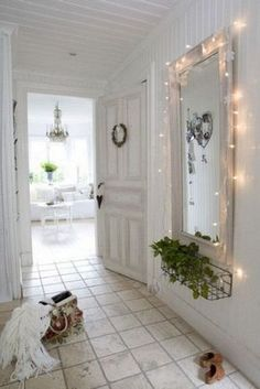 Wood framed wall mirror with fairy lights around. Romantic shabby chic charm!