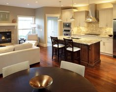 Would love to knock down some walls, and do something like this combining kitchen, family room and dining area.
