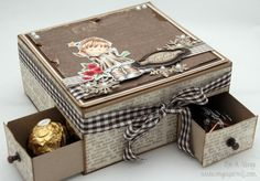 Box with chocolate hearts on top, drawers with Ferrero Rocher and Anthon Berg chocolate underneath.