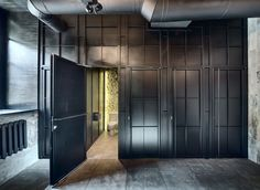 An understated elegance emerges from the rough and dark industrial interior of Dogs&Tails café and bar in Kiev, Ukraine, designed by Sergey Makhno Architects. Restaurant Design, Restaurant Bar, Industrial Restaurant, Restaurant Interiors, Retail Image, Brick Cafe, Dog Toilet, Kiev Ukraine, Industrial Interiors
