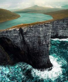 Via The Lake on a cliffs of ocean. Sørvágsvatn (or Leitisvatn) is the biggest lake of the Faroe Islands, situated on the island of Vágar. It covers an area of square km. Photo by Places To Travel, Places To See, Travel Destinations, Wonderful Places, Beautiful Places, Beautiful Pictures, Places Around The World, Around The Worlds, Destination Voyage