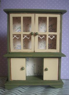 I just got one of these at Michaels for $1!dollhouse miniature kitchen / cottage hutch