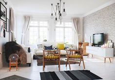 Make a white space brighter with painted brick. Light eggshell tones create a contrast with cage lighting, white wooden floors and touches of fur.