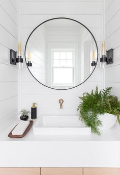 modern farmhouse bathroom with round mirror and shiplap A Beachside Mediterranean-Style Summer Home in Allenhurst, NJ Interior Design Trends, Beach House Decor, Home Decor, Beach Houses, Beach House Lighting, Decor Room, Scandinavian Style Home, Mediterranean Decor, Ship Lap Walls