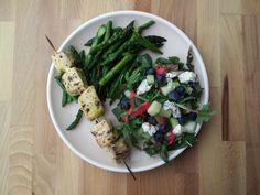 herb marinated swordfish skewers sautéed asparagus.  italian summer salad with fresh raspberry dressing.