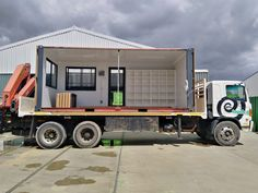 Constructed from two conjoined B-grade shipping containers, this spacious maintenance office doubles as a storage room and includes an ablution facility with a toilet and sink. Shipping Container Conversions, Shipping Containers, Mobile Office, Storage Room, Storage Containers, Toilet, Sink, Construction, Pantry Room