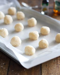 Dark Chocolate Coconut Bites: cute little truffles that only require four ingredients. 130 calories of natural sweetness! | pinchofyum.com