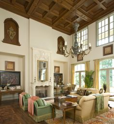 Formal living area of a French Classical House in Highland Park, TX. Coffered ceiling detail in stained wood. French Architectural designs by Richard Drummond Davis Architecture.