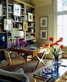 dens/libraries/offices - jan showers bookshelves animal rug office library Sand beige flat bar chairs, walnut x desk, purple lamp, built-ins,
