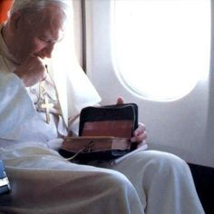 Pope John Paul II, praying while traveling. (Needed now a days - More prayer less talk.)