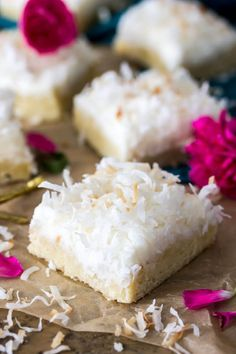 Coconut Cream Bars! Buttery soft cookie bars topped with a light refreshing coconut cream frosting and topped off with toasted shredded coconut.