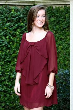 VaVa has arrived at The Pink Nickel! Gorgeous bow dress in a great wine color