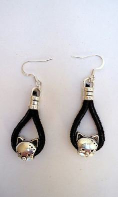 dangling silver tone cat earrings on black suede by JoolsbyAveril