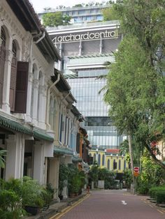 An Orchard Street mall looms over a row of colonial houses in Emerald Hill, Singapore. Singapore Attractions, Singapore Photos, Street Mall, Southeast Asia, Portuguese, 6 Years, Colonial, The Row, Beautiful Places
