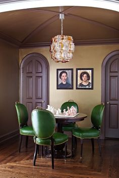 Vintage emerald green chairs. Like family portraits on wall.