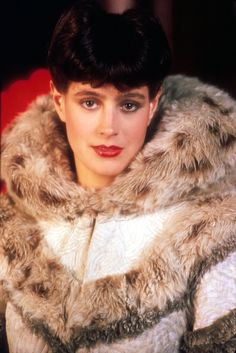 "Sean Young was supposed to play Vicki Vale in ""Batman,"" but broke her arm while horseback riding and had to give up the role. But she had achieved leading lady status earlier in the decade, playing Rachael in dystopian sci-fi flick ""Blade Runner. Sean Young Blade Runner, Rachel Blade Runner, Film Blade Runner, Blade Runner 2049, Classic Movie Stars, Classic Films, Sci Fi Films, Pulp, Young Actresses"