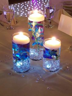 Hanging unscented candles certainly are a easy way to put that designer's feel to really cutlery, center pieces and floral vases. Just add plants, portion hyperlinks or colorful plain water. Floating Candle Centerpieces, Floral Centerpieces, Pillar Candles, Wedding Centerpieces, Wedding Decorations, Purple Wedding, Floral Wedding, Wedding Colors, Wedding Flowers
