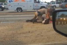 Video Catches Cop Viciously Beating Woman On The Side Of The Road. Always amazing how many people video and don't help.