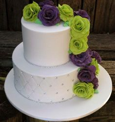 Florence had a green and purple theme to her special day and asked if we could make green and purple roses trailing down two tiers of cake. Description from simplystunningcakes.com.au. I searched for this on bing.com/images