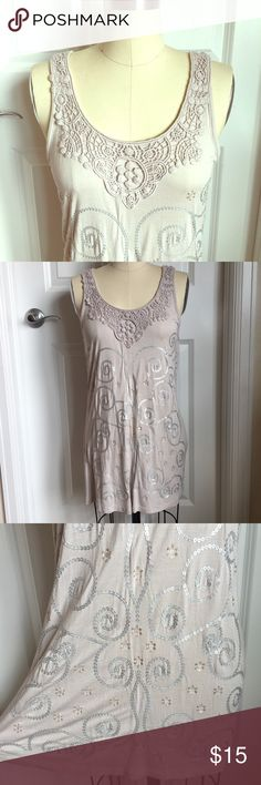 Adorable Tank W/Details Adorable tank with silver & gold sequins detail on front. Embroidered at neck & adorable loop hole & tie on the back. Perfect with shorts & sandals for summer! Tops Tank Tops