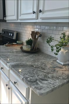 granite kitchens kitchen desk ideas eat in and cook monogram white 2019 grey tile backsplash splash board blue cabinets