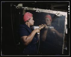 "Operating a hand drill at Vultee-Nashville, woman is working on a ""Vengeance"" dive bomber, Tennessee."