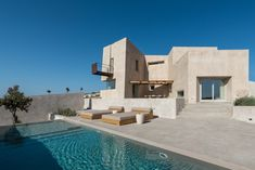 Completed in 2018 in Pyrgos, Greece. Images by Giorgos Sfakianakis. The summer residence is located on the outskirts of the traditional village of Pyrgos in Santorini. The building is placed on a mild sloping plot. Contemporary Summer Houses, Wooden Pergola, Architect House, Pergola Shade, Toscana, Residential Architecture, Contemporary Architecture, Amazing Architecture, Greek Islands