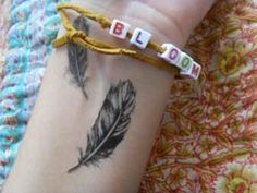 Get a feather tattoo, maybe not on wrist but I love this one!
