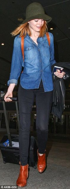 Coordinated: The Amazing Spider-Man star sported brown ankle boots that matched the brown of her leather knapsack as she strode through the ...