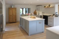 Wonderfully clean and simple L&H kitchen painted in Farrow and Ball 'Ammonite' and 'Purbeck Stone' (island).