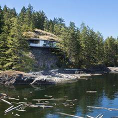 3-luxury-green-roofed-island-home-large-boulder.jpg