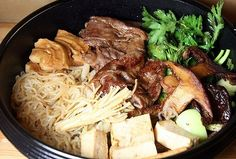 Sukiyaki is a type of one-pot dish that is cooked in a shallow cast-iron pot. Traditionally, it contains beef, but some parts of Japan use pork. Vegetarians can substitute tofu and big, meaty mushrooms such as matsutakes. Other ingredients include  negi (a Japanese leek,) konnyaku noodles (these are called shirataki), and shungiku……