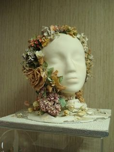 An absolutely life-like 3-D cake with head and flowers.