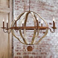 """Regina Andrew Design marries vintage style with modern flair for a home collection that's truly timeless. A three-dimensional quatrefoil creates the spherical shape of this wooden chandelier. Rusted curved arms support 8 lights for a warm, inviting glow above a dining room table.  Chandelier measures 42"""" round x 30""""H  8-B type bulbs, max 40 watts each bulb  View entire Regina-Andrew Designs collection    RA405701"""