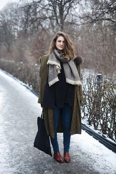 olive coat + black shirt + blanket scarf + skinny jeans + brown ankle boots